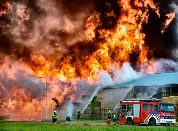Fire fighting in an industrial area stock photo