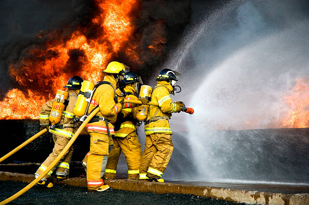 fire fighting - firefighter stock photos and pictures