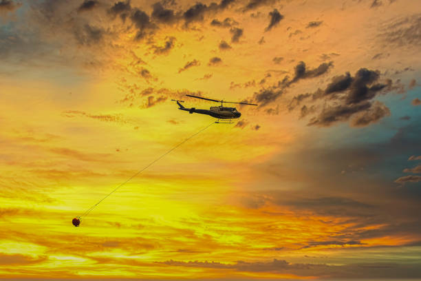 Fire fighting water bombing helicopter in The Blue Mountains in Australia stock photo