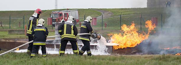 Fire fighting with special extinguishing foam - foto de stock