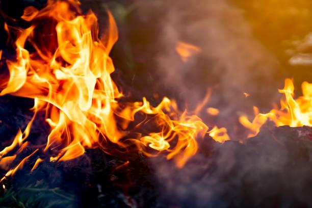 fire flame and smog of burning garbage in public garden to air pollution of community - white background zdjęcia i obrazy z banku zdjęć