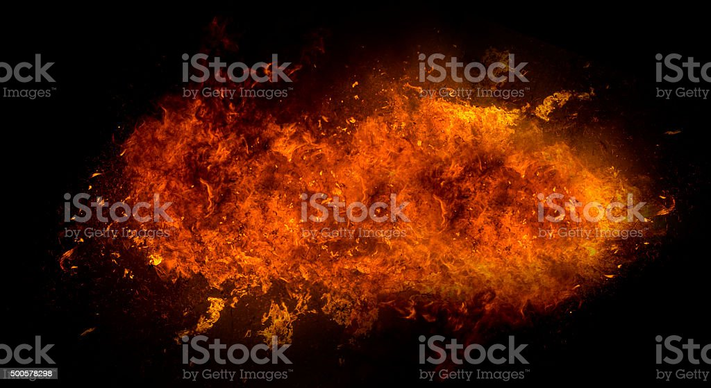 Fire flame explosion on black background stock photo