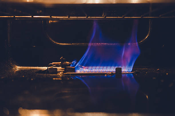 fire flame inside of the gas oven stock photo