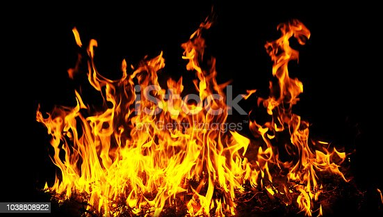 istock Fire flames on a black background. 1038808922