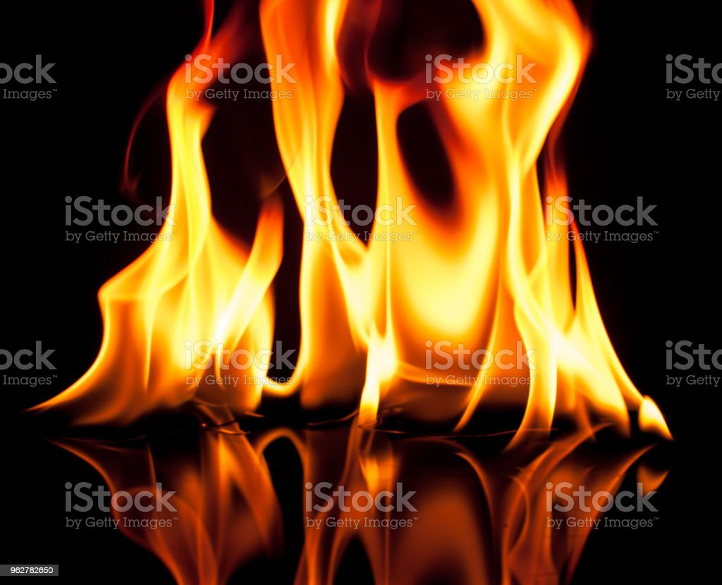 Fire flames on a black background - Foto stock royalty-free di Ambientazione interna