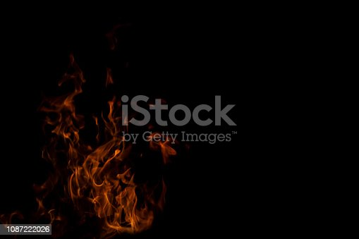 istock Fire flames on Abstract art black background, Burning red hot sparks rise from large, Fiery orange glowing 1087222026