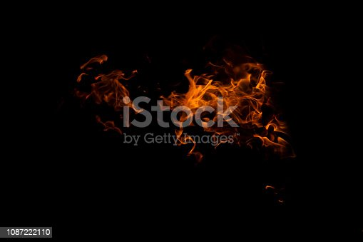 istock Fire flames on Abstract art black background, Burning red hot sparks rise from large 1087222110
