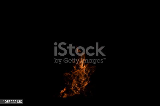 istock Fire flames on Abstract art black background, Burning red hot sparks rise from large 1087222130