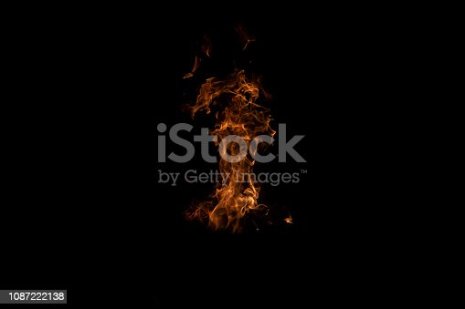 istock Fire flames on Abstract art black background, Burning red hot sparks rise from large 1087222138