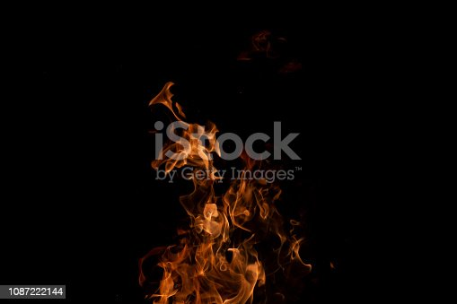 istock Fire flames on Abstract art black background, Burning red hot sparks rise from large 1087222144