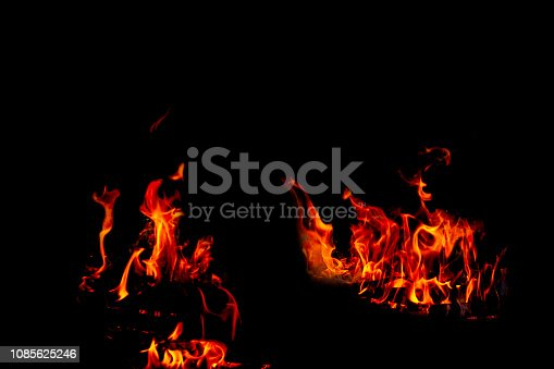 istock Fire flames on Abstract black background, Burning red hot sparks rise from large fire in, Fiery orange glowing 1085625246