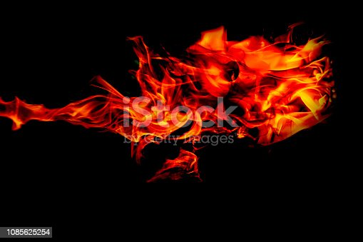 istock Fire flames on Abstract black background, Burning red hot sparks rise from large fire in, Fiery orange glowing 1085625254