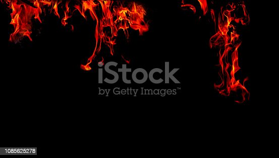istock Fire flames on Abstract black background, Burning red hot sparks rise from large fire in, Fiery orange glowing 1085625278