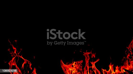 istock Fire flames on Abstract black background, Burning red hot sparks rise from large fire in, Fiery orange glowing 1085625290
