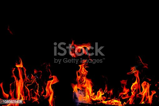istock Fire flames on Abstract black background, Burning red hot sparks rise from large fire in, Fiery orange glowing 1085625408