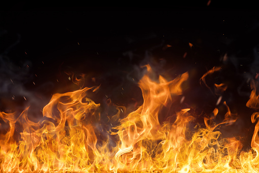 istock Fire flames on black background 859731574