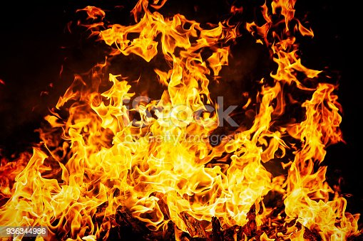 istock Fire flames on black background 936344986