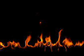 Fire flames on the black background
