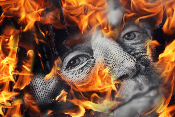 Fire flames over one hundred dollar bill Fire flames over one hundred dollar bill money to burn stock pictures, royalty-free photos & images
