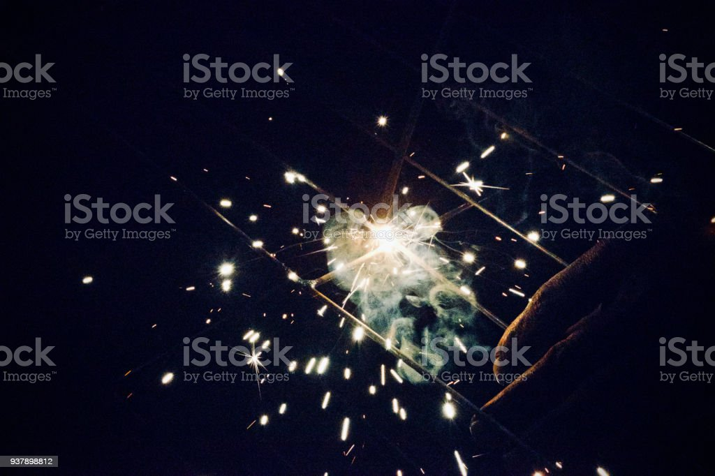 Fire flames with a human hand isolated photograph stock photo