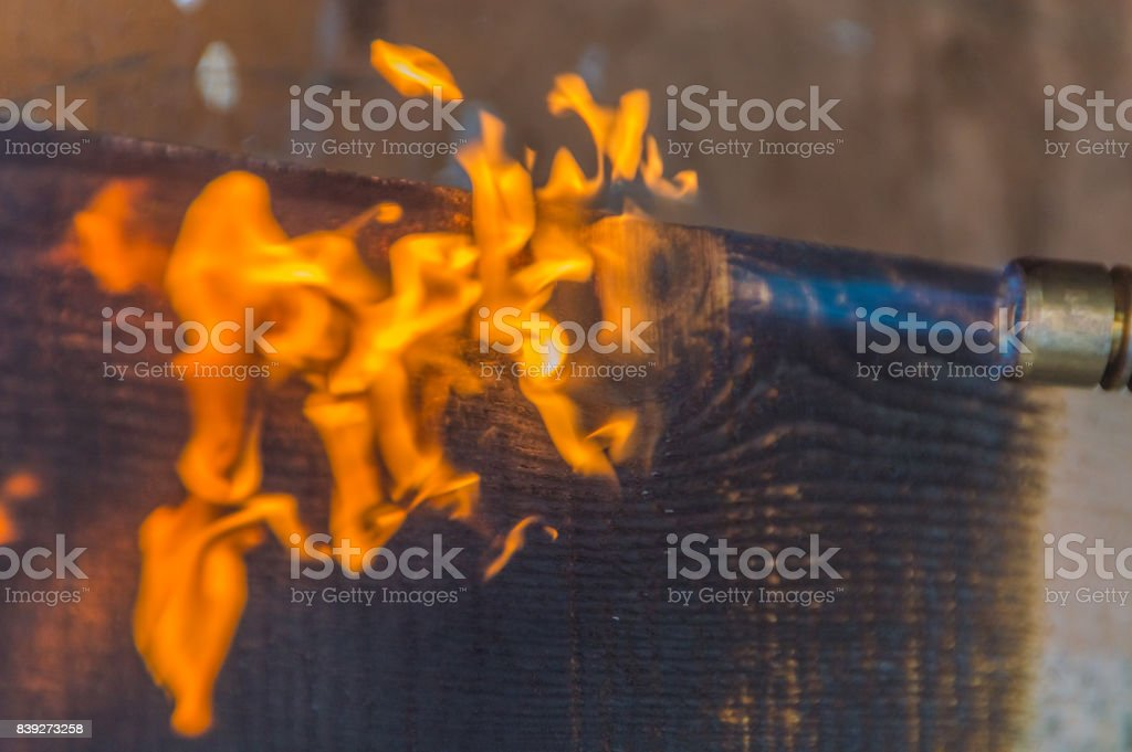 fire from a gas burner is processed charred wood stock photo
