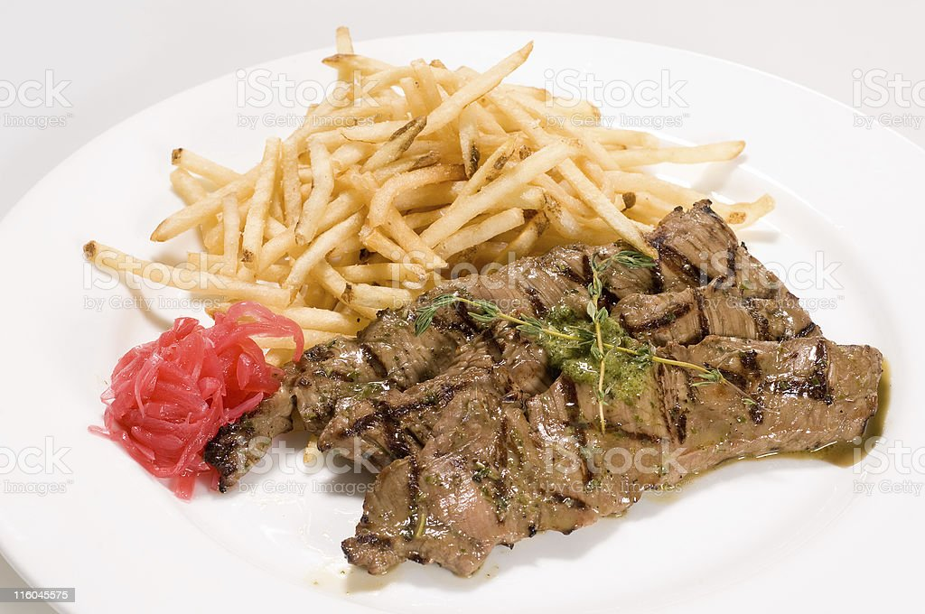 fire grilled veal flank steaks with fries (london broil) 2 royalty-free stock photo