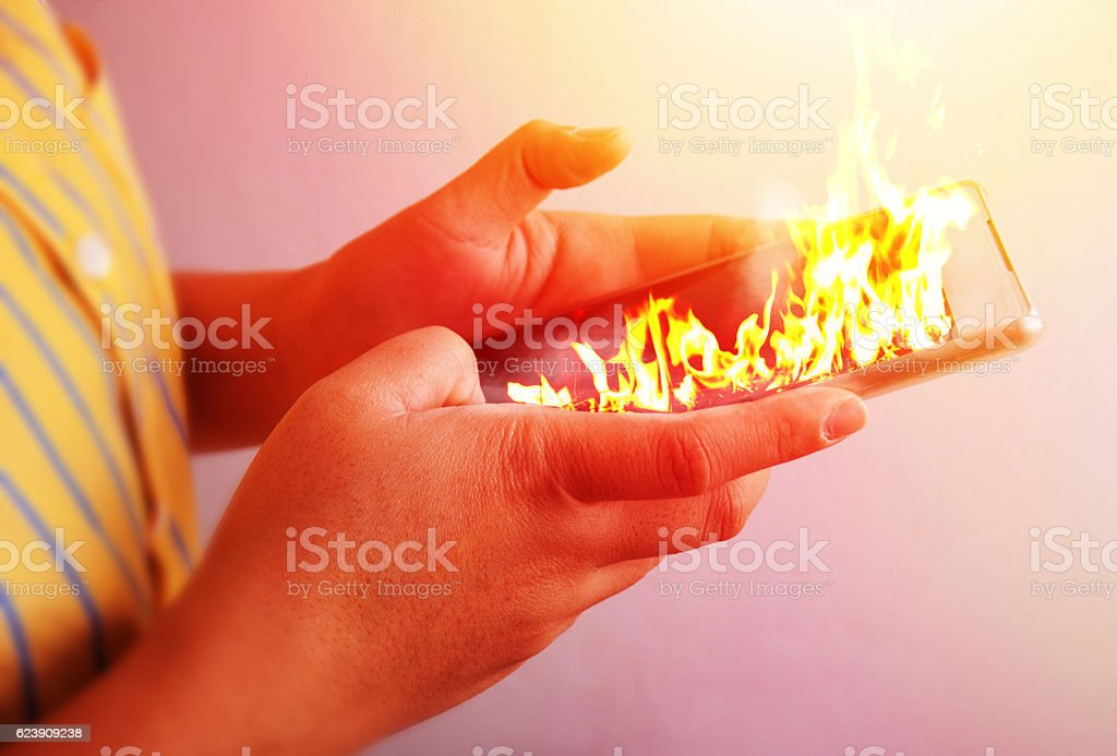 Fire hand hold fire smartphone. bildbanksfoto