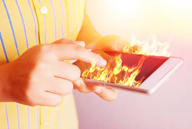 Fire hand hold fire smartphone. Telephone, Fire - Natural Phenomenon, Battery, Exploding, Mobile Phone dumpster fire stock pictures, royalty-free photos & images