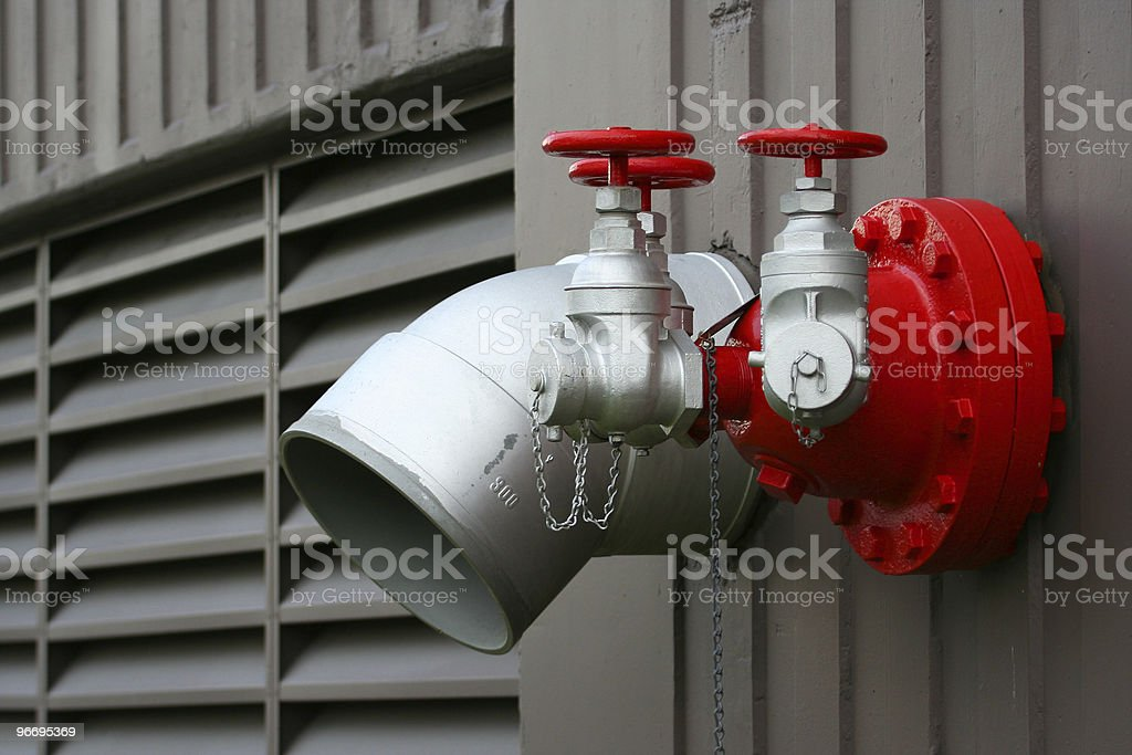 Fire Hookups on a Commercial Building royalty-free stock photo