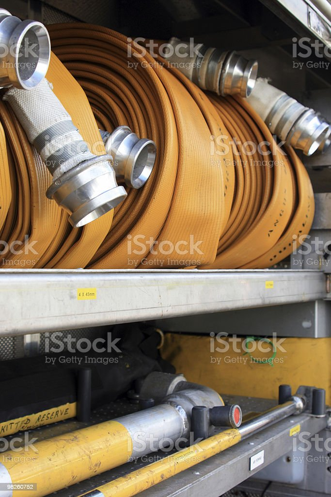 Fire hose and other equipment on a fire truck royalty-free stock photo