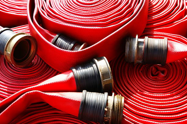 fire Hose fire protection systems, piping for water pipes fire hydrant stock pictures, royalty-free photos & images