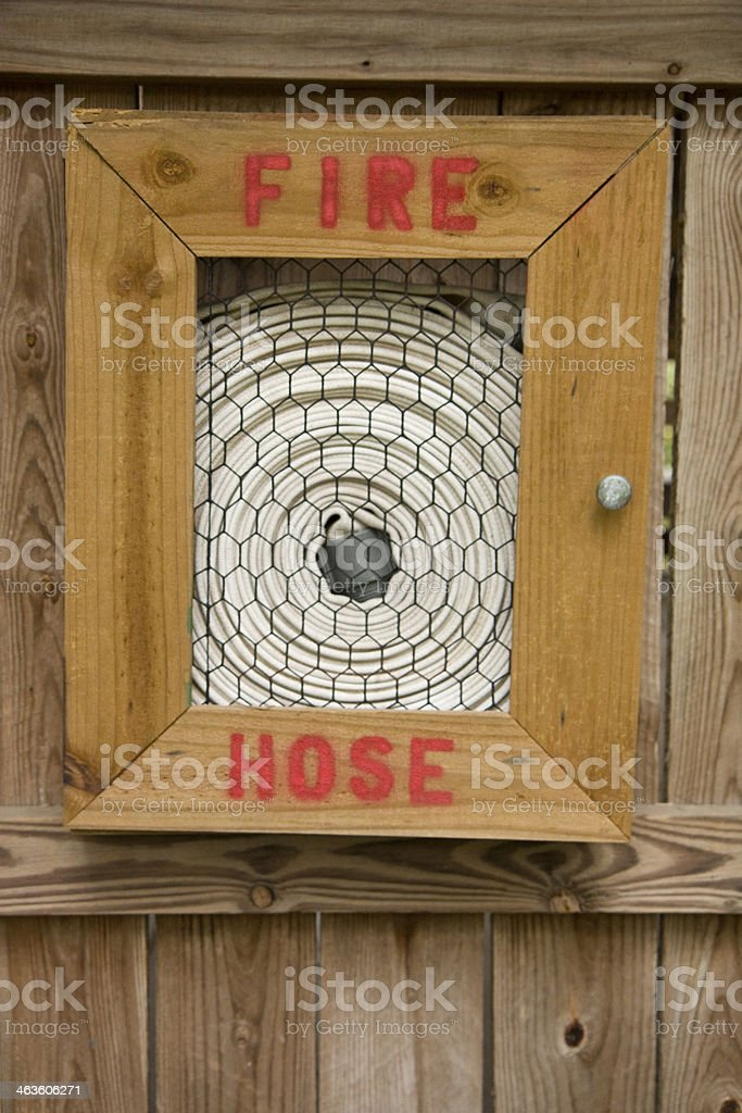 Fire Hose wrapped on a Wooden Fence. royalty-free stock photo