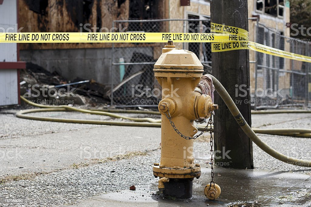 Fire Hydrant and arson damage stock photo