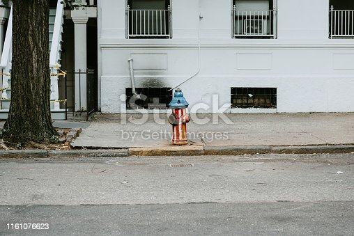 Fire hydrant colored in America's flag colors on a  street in Brooklyn, New York