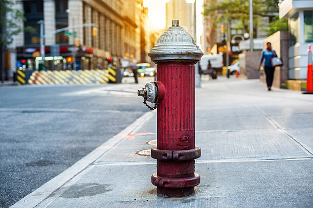 Fire hydrant for emergency fire access on city street Old red fire hydrant in New York City street. Fire hydrant for emergency fire access fire hydrant stock pictures, royalty-free photos & images
