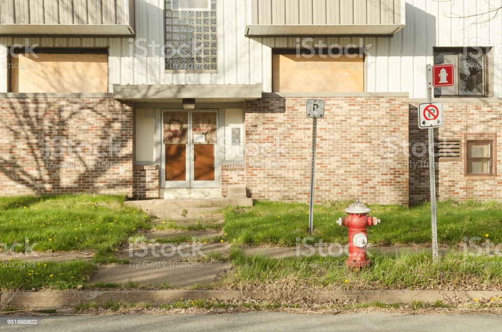 Fire Hydrant in front of apartment building stock photo