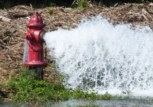 Fire Hydrant Fire Hydrant flushing out the water. fire hydrant stock pictures, royalty-free photos & images