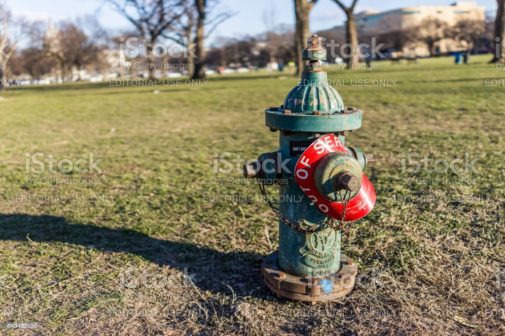 Fire hydrant with out of service red sign stock photo