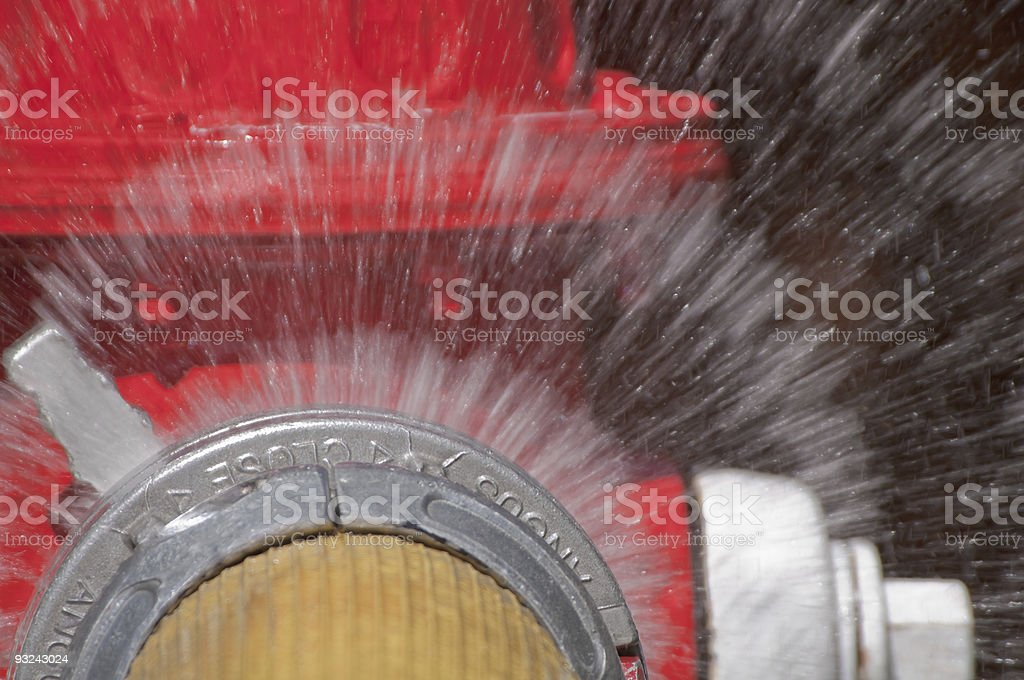 Fire hydrant with water spray close up stock photo