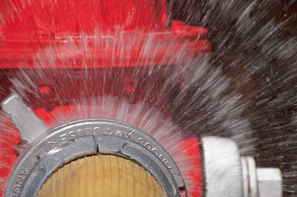 Fire hydrant with water spray close up  fire hydrant stock pictures, royalty-free photos & images