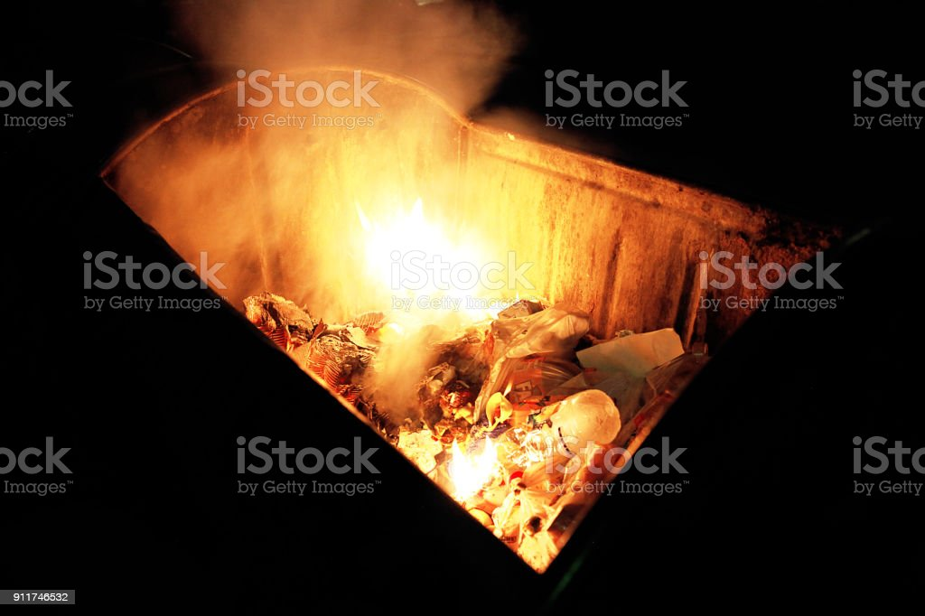 Fire in a dumpster stock photo