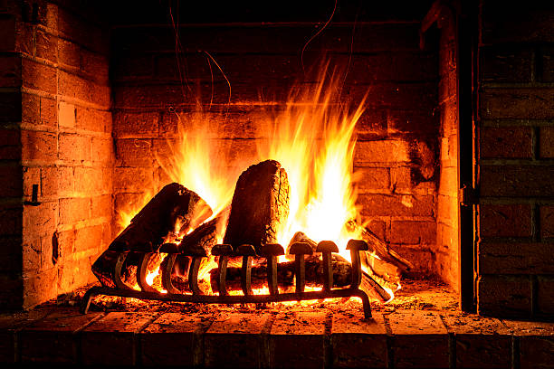 Fire in a fireplace Wood fire in a fireplace log fire stock pictures, royalty-free photos & images