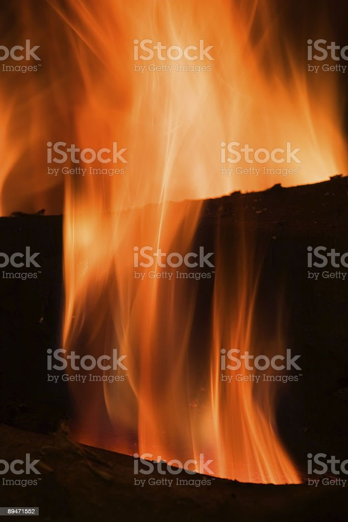 Fire in a fireplace royalty-free stock photo