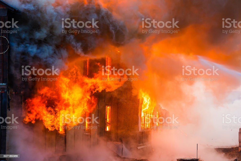 Fire in a house stock photo