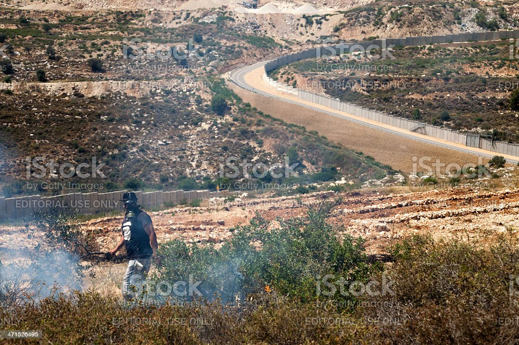 Fire in a Palestinian Field by Wall of Separation royalty-free stock photo