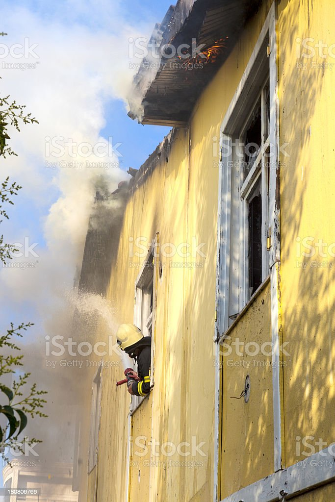 Fire in an yellow house. royalty-free stock photo