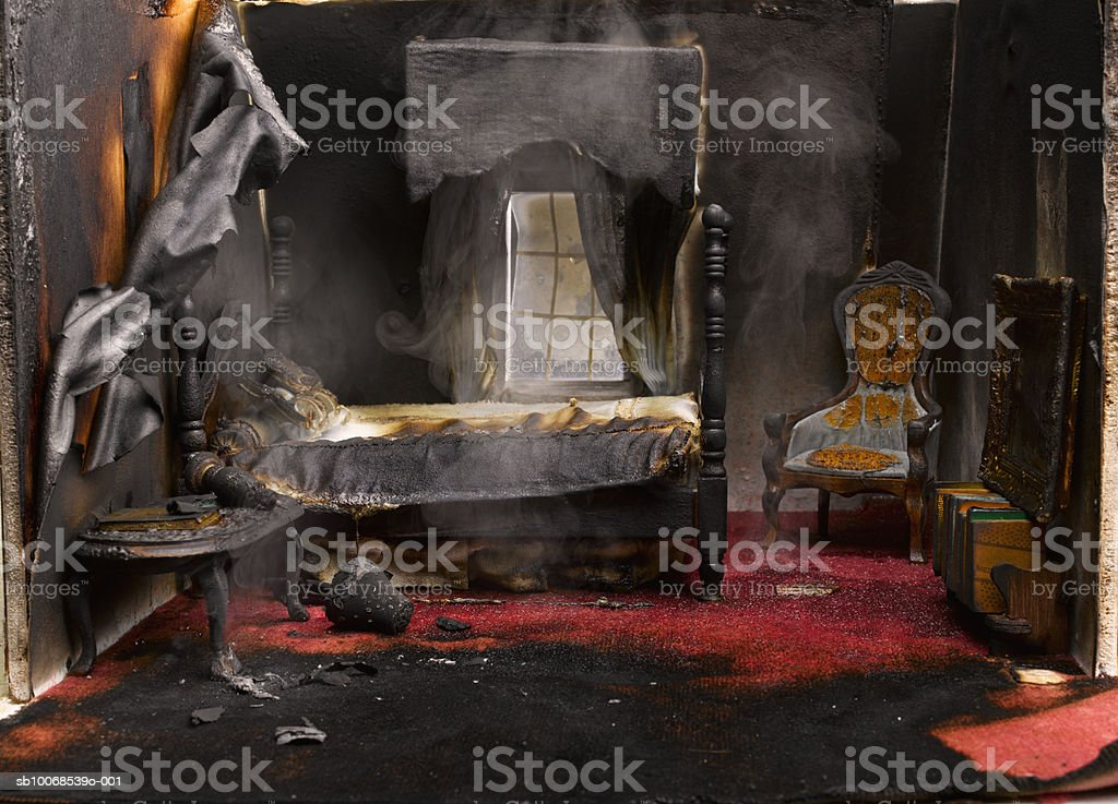 Fire in bedroom of model house, close-up 免版稅 stock photo