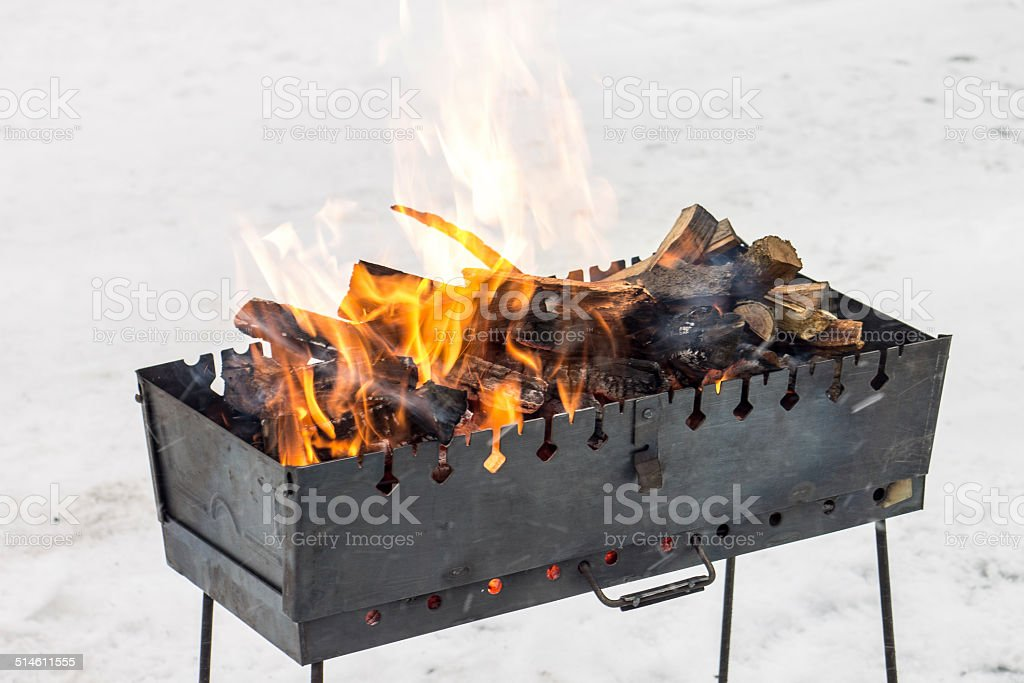 Fire in brazier at winter outdoor stock photo