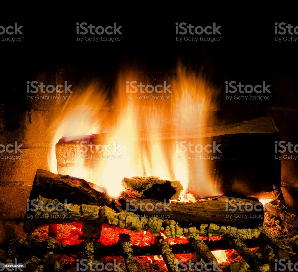Fire In Fireplace .  Isolated. Extreme Close stock photo