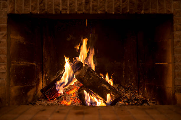 Fire in fireplace Logs burning in fireplace. log fire stock pictures, royalty-free photos & images